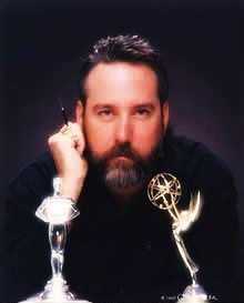 Photo of Pete Mitchell with NATAS Emmy(tm)